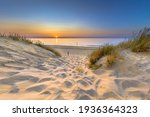 Inviting Sunset View over ocean from dune over North Sea and Canal in Ouddorp, Zeeland Province, the Netherlands. Outdoor scene of coast in nature of Europe.