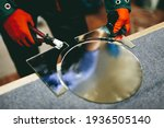Glazier worker cutting glass...