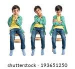boy thinking on wooden chair... | Shutterstock . vector #193651250