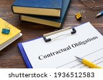 Small photo of Agreement with Contractual obligations list on the table.