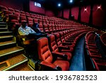Moviegoers Sitting In A...
