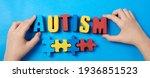 Autistic Kid Hands Holding...
