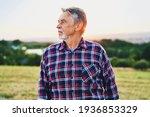 Senior Man Looks Over His Land...