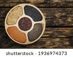 mix of legumes in wood bowl... | Shutterstock . vector #1936974373