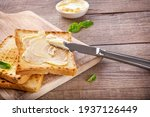 Knife Spreading Butter On Toast ...
