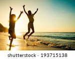 happy kids playing on beach at... | Shutterstock . vector #193715138