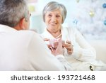 mature woman taking small pink... | Shutterstock . vector #193721468