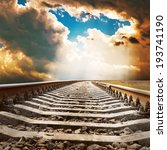 dramatic sky over railroad - stock photo