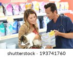 Stock photo veterinarian showing pet food to client 193741760