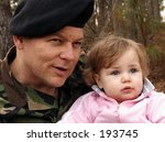 american army soldier with baby - stock photo