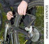 fixing a mountain bike chain... | Shutterstock . vector #19374715