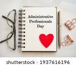 Small photo of Admin Day Greeting Card. Close-up, view from above, wooden surface. Concept of preparation for a professional holiday. Congratulations for relatives, friends and colleagues