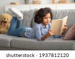 Black girl lying on the sofa ...