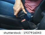 Woman Hand Fastening A Seatbelt ...