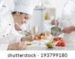 Closeup On A  Female Chef...
