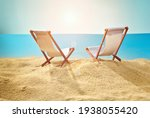 Beach Chairs On The Sand....