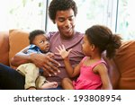 father relaxing on sofa with... | Shutterstock . vector #193808954