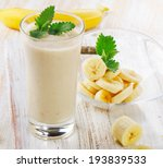 Banana Smoothie On A Wooden...