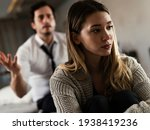 Small photo of Husband and wife are arguing at home. Angry man is yelling at his wife