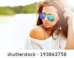 Closeup fashion beautiful woman portrait wearing sunglasses