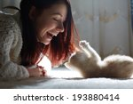 Stock photo girl with a kitten 193880414