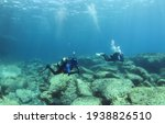 Small photo of Diving instructor and student in underwater exercise. Instructor teaches student to dive. Underwater scuba diving education and training.