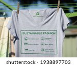 Small photo of T shirt on washing line with sustainable fashion label, care for the earth, respect for workers, trade fair, mend and repair, reuse, swap or donate with icons.