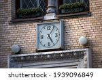 Old Vintage Clock On The Brick...