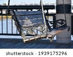 Outdoor Swing Bench In The...
