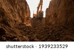 The Excavator Digs A Trench For ...