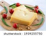 Gruyere cheddar cheese on wooden background. Local name kars gravyer peynir