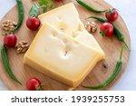 Gruyere cheddar cheese on wooden background. Local name gravyer peynir