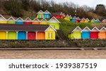 Brightly Coloured Beach Huts At ...