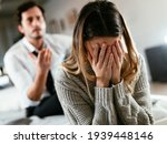 Small photo of Boyfriend and girlfriend are arguing at home. Angry man is yelling at his sad girlfriend.