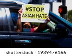 A Woman Shows A Sign In Her...