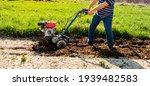 A Man Plows The Ground With A...