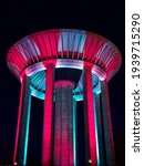 Hiekkaharju Water Tower in Vantaa Finland. The colorful lights of the water tower at night.
