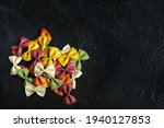 Colored Raw Pasta On A Black...