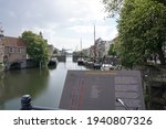 Small photo of Rotterdam, The Netherlands - May 9, 2019; View of the De Piet Heynsbrug over the Aelbrechtskolk in the Rotterdam district of Delfshaven. In the foreground a board with explanatory text.