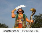 Small photo of Statue of the mythological Hindu demon Mahishasura at Chamundi Hill in Mysore, India. The statue of the demon bears a sword in his right hand and a cobra in the left.