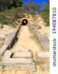 Small photo of Entrance tunnel to the ancient stadium near the sanctuary of Nemea, Greece