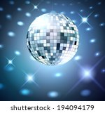 silver disco ball on glowing...