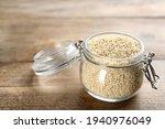 Sesame Seeds In Jar On Wooden...