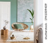 Small photo of Modern composition of living room interior at fancy apartment with gray sofa, rattan armchair, wooden cube, plaid, tropical plant and elegant accessories. Stylish home decor. Template.