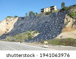 Small photo of NEWPORT BEACH, CALIFORNIA - JANUARY 16, 2017: Plastic Covered Hillside. Newport Bluffs hillside covered with plastic to prevent erosion. Seen from Back Bay Drive.