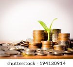 money coins pile and young tree ... | Shutterstock . vector #194130914