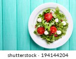 green salad made with  arugula  ... | Shutterstock . vector #194144204