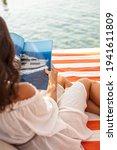 Woman Sitting At  Cabana And...