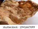 Small photo of Pork skin or pork rind on a table dark food photography of large pork rind or CHICHARRON chicharrones