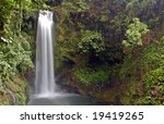 Small photo of A beautiful waterfall in the mountains of Costa Rica. Shot with a long exposure to blur water movement. Please see my portfolio for other Costa Rica Pictures